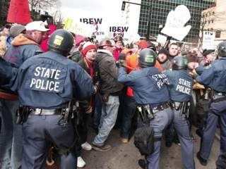 Michigan State Police manhandling protesters.